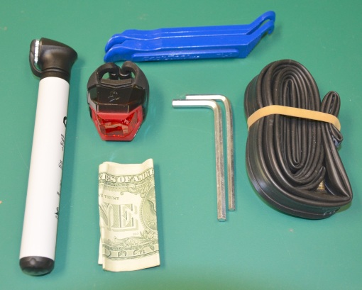 Super-light road kit (carried in jersey pocket): mini pump, rear flashy light, tire levers, Ikea hex wrenches, tube, dollar bill
