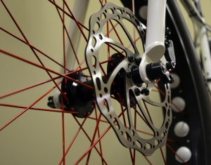Sweet-looking red spokes and wavy disc rotor