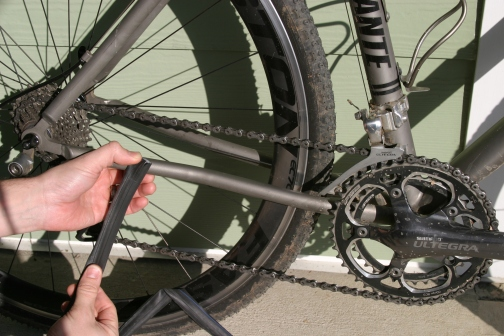 Start by holding the tube onto the chainstay about an inch behind where you think the chain slap will start.