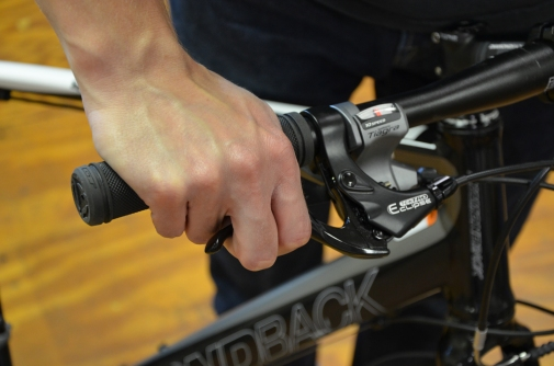 Squeeze the brake levers and try to push the bike forward