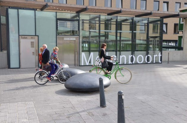 This mom and daughter in Hasselt, Belgium are just going about their business-- no helmets needed