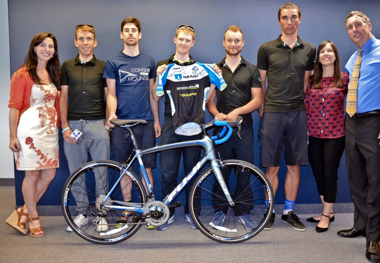 Members of Team NetApp posed for a photo with the Fuji Bikes team