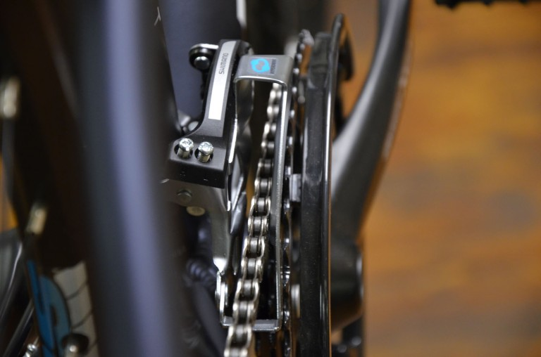 A metallic scraping noise usually comes from the chain rubbing against the front derailleur, as seen here