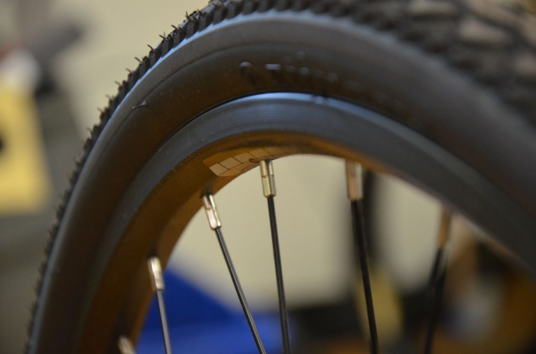 "Loose wheel spokes often cause a high pitched ""singing"" noise when riding"