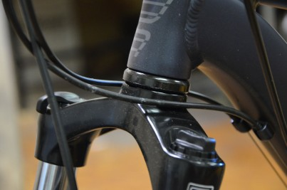 Cables and cable housing can slap against the frame, making a rattling sound