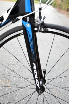 Compliance tuned fork for a responsive, smooth ride