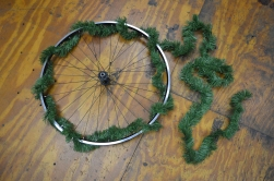 Step 2: Weave the garland in between the spokes and around the rim