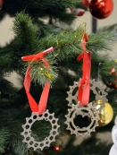 Tie some festive string around each cog (or multiples) and hang them up.
